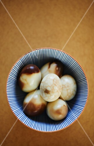 Hard-boiled eggs stained with tea (shelled)