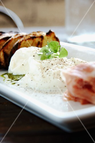 Burrata (cow's milk cheese, Italy) with ham and grilled bread