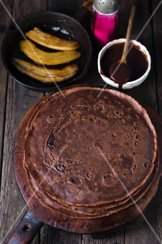 Chocolate crepes with caramelised bananas