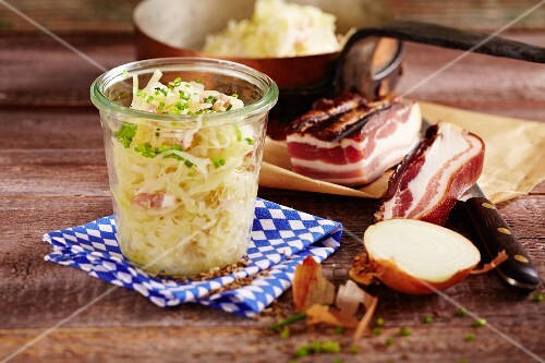 A jar Bavarian coleslaw with onions and bacon