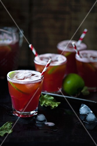 A cocktail with vodka, limes, cranberry and apple juice