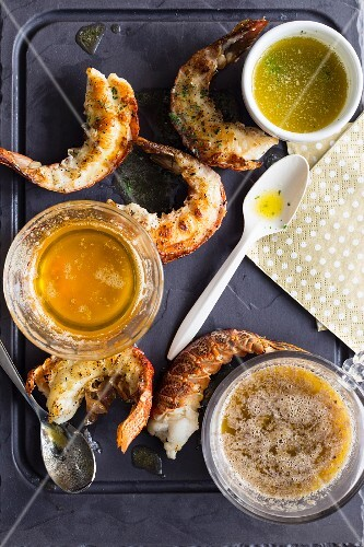 Grilled prawns with various butter sauces for Christmas