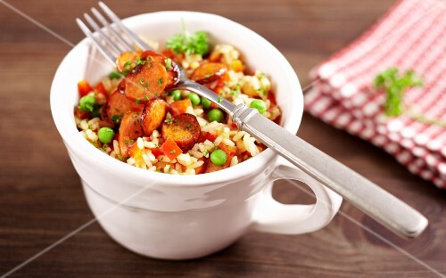 Colourful rice with Hungarian debrecener sausages