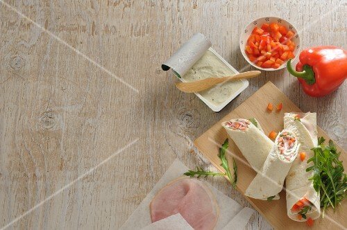Wraps with peppers, ham and cream cheese