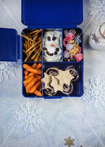 Various winter snacks in a plastic box with compartments