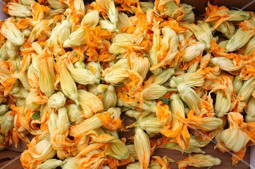 Courgette flowers in a box at a market