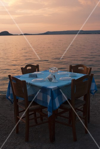 A table laid for four with a seaview