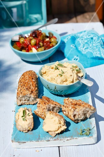 Wholemeal baguette with hummus and pickled olives