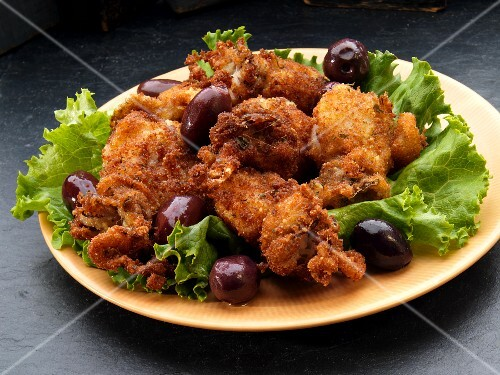 Fried, breaded squid with olives