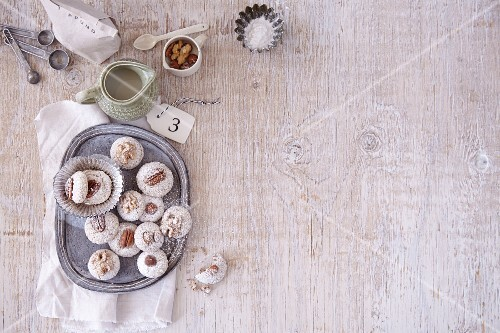 Macaroons with ingredients and baking utensils for Christmas