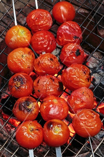 Tomato skewers on the barbecue, Laos