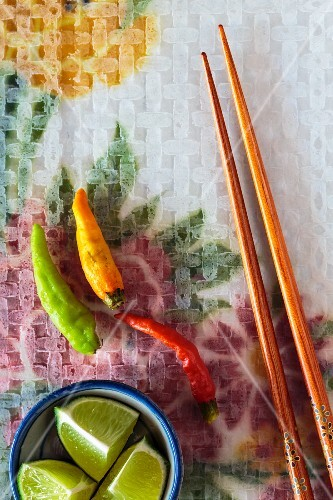 Chilli peppers, chopsticks and limes
