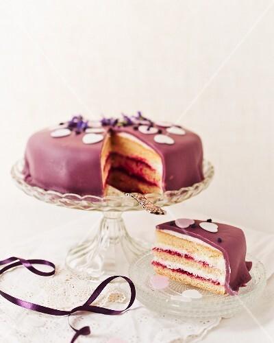 Raspberry cake with a purple marzipan coating