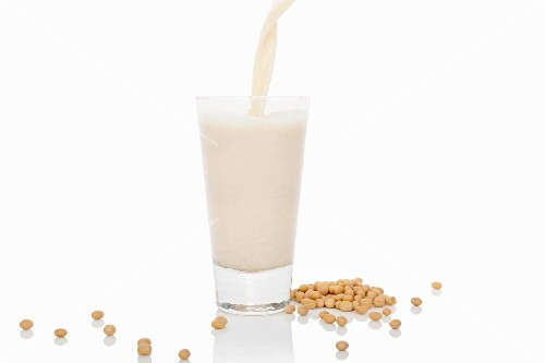 Soya milk being poured into a glass