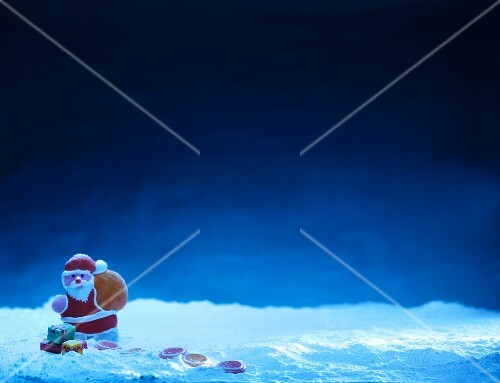 Father Christmas against a blue night sky