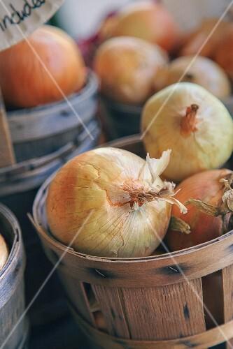 Onions in wooden baskets