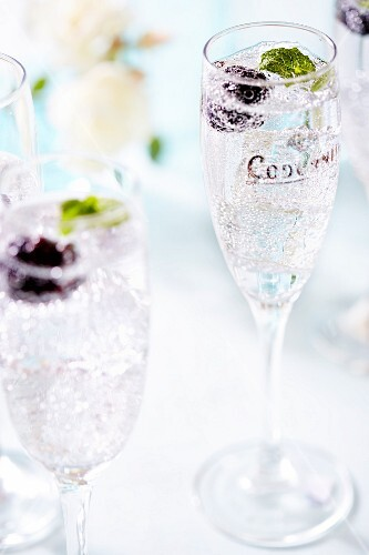 Blackberries in glasses of champagne