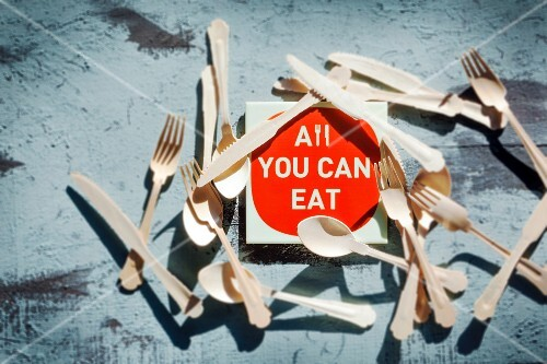 An 'All you can eat' sign surrounded by cutlery