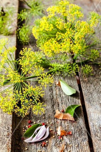 Dill flowers on a wooden surface