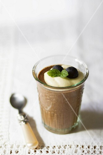 Chocolate mousse with cream, fresh mint and grapes