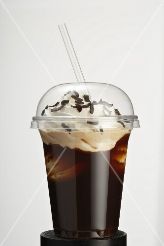 Iced coffee with cream and grated chocolate in a takeaway cup