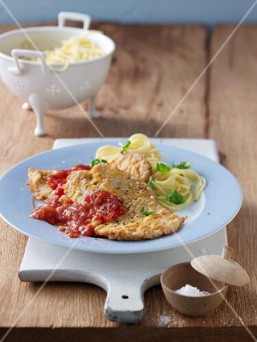 Piccata Milanese with spaghetti and tomato sauce