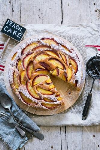Peach cake with icing sugar