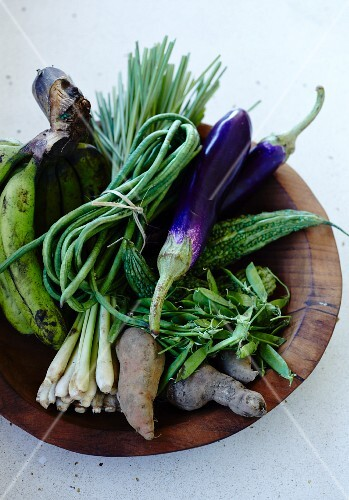 Exotic vegetables in a wooden bowl