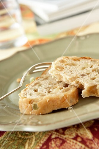 Two slices of diabetic stollen with almonds and candied fruit