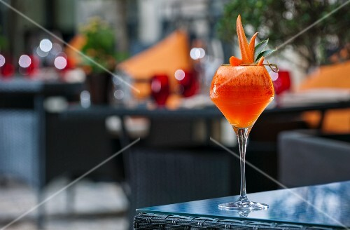 A cocktail garnish with melon carrots on a patio table (Buddha-Bar Hotel, Paris)