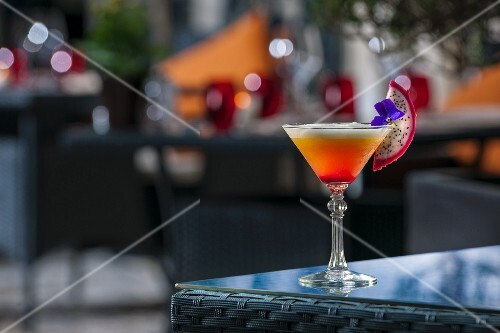An exotic fruit cocktail on a patio table (Buddha-Bar Hotel, Paris)