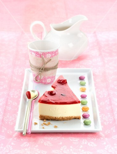 A slice of cheesecake with red jam
