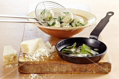 Spinach dumplings with sage butter and Parmesan cheese