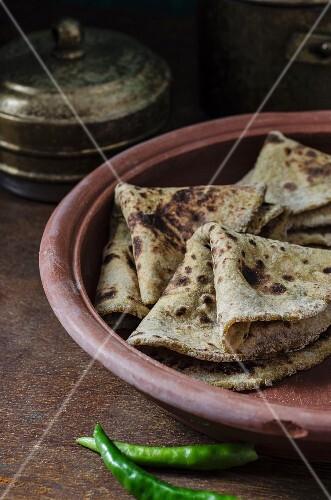 Sweet potato paratha in a terracotta dish (India)