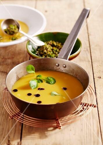 Pumpkin soup with lamb's lettuce and orange gremolata