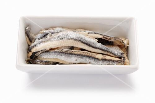 Sardine fillets preserved in oil in a porcelain dish