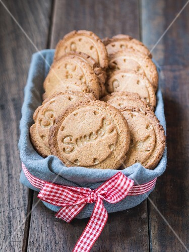 Healthy cardamom biscuits stamped with the word 'Sweet'