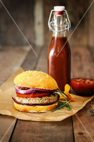 A quinoa burger in a sweet potato bun