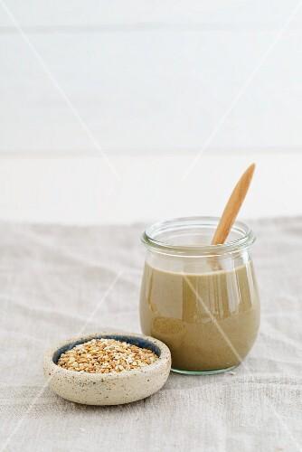 A jar of tahini (sesame seed paste)