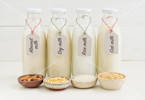 Bottle of almond milk, soya milk, rice milk and oat milk