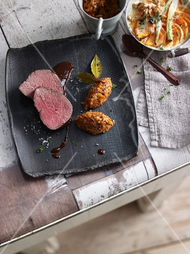 Poached beef fillet with sweet potatoes and pumpkin chutney