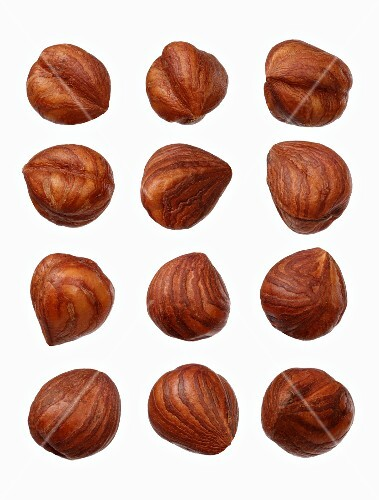 Twelve hazelnuts on a wooden surface