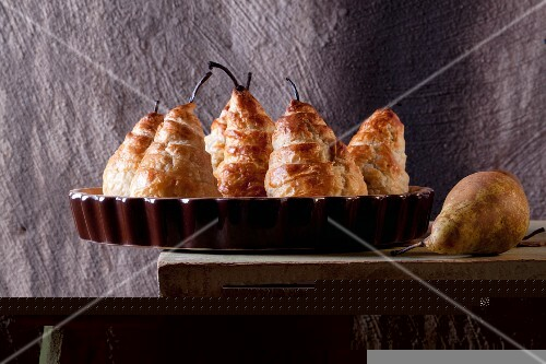 Pears wrapped in puff pastry filled with cheese and walnuts