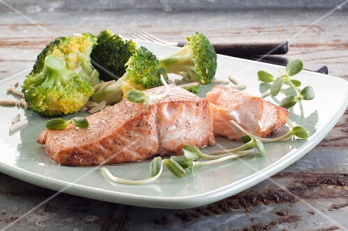 Salmon fillet with broccoli florets and sunflower shoots