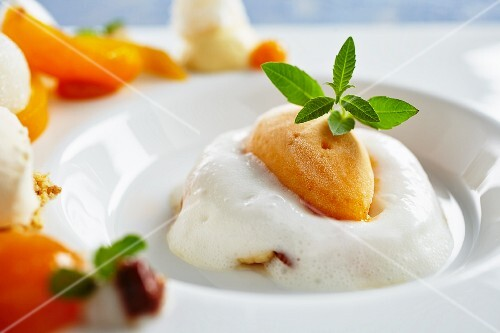 Apricot and elderberry dessert garnished with mint leaves