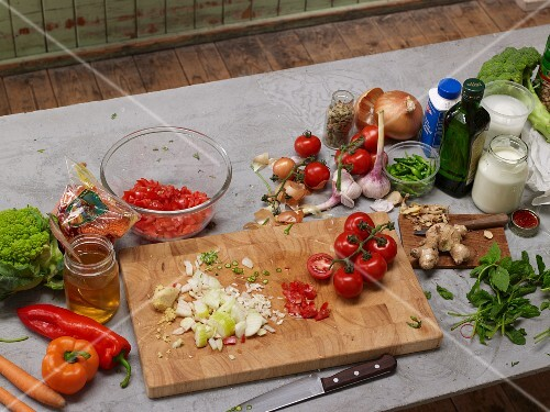 Chopped vegetables and ingredients for vegetarian dishes on a grey platter
