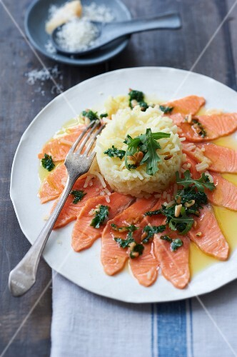 Salmon trout slices with a herb and lemon sauce with rice