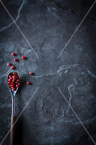 Red peppercorns on a spoon