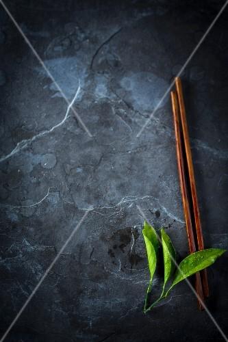 Chopsticks and lemon leaves