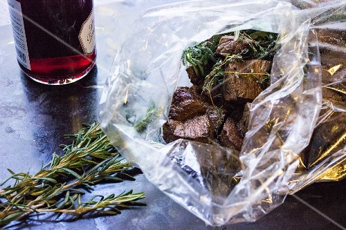 Slow-roast boeuf bourguignon in a plastic bag